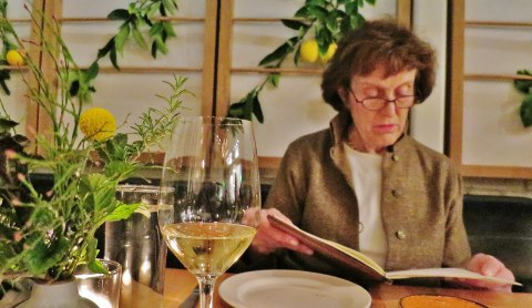 Linda contemplates the wine list at Ninebark in Napa.